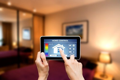 person using ipad to manage energy usage
