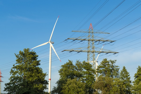 electricity pylon and wind turbine