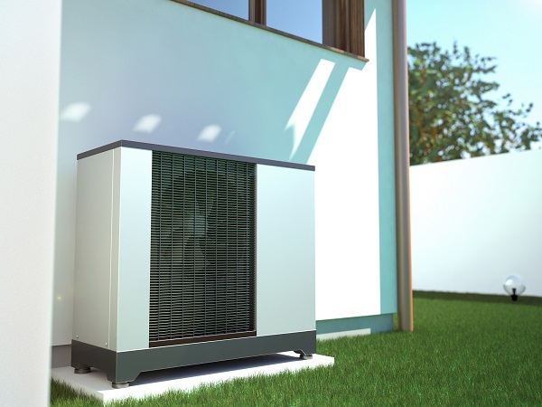 heat pump outside home - the sun is shining